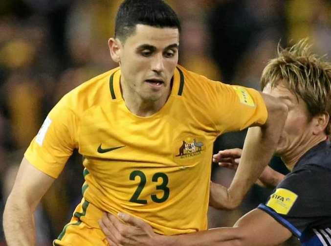 Tomas Rogic of Australia and Genki Haraguchi of Japan contest possession during the 2018 FIFA World Cup qualifier at Etihad Stadium in Melbourne.
