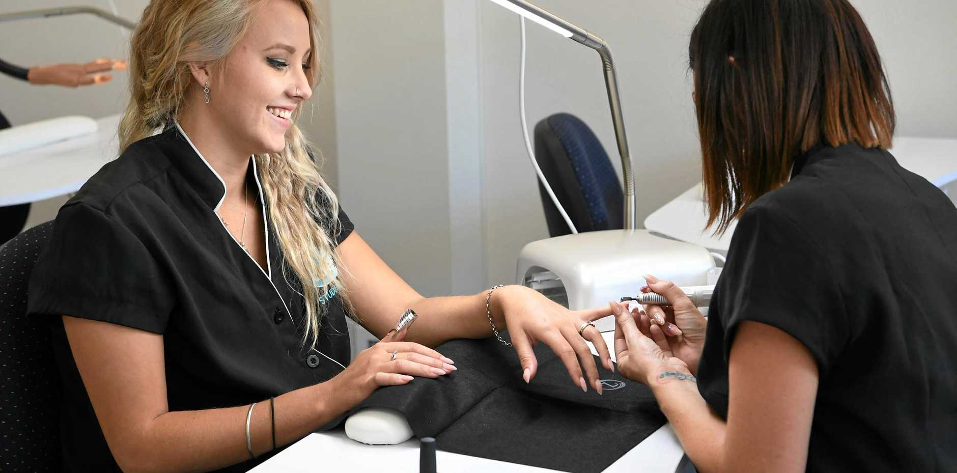 HAIR AND BEAUTY: Cert II Nail Technology students Chrissy Thompson and Jenna Brown at the newly refurbished TAFE beauty salon.