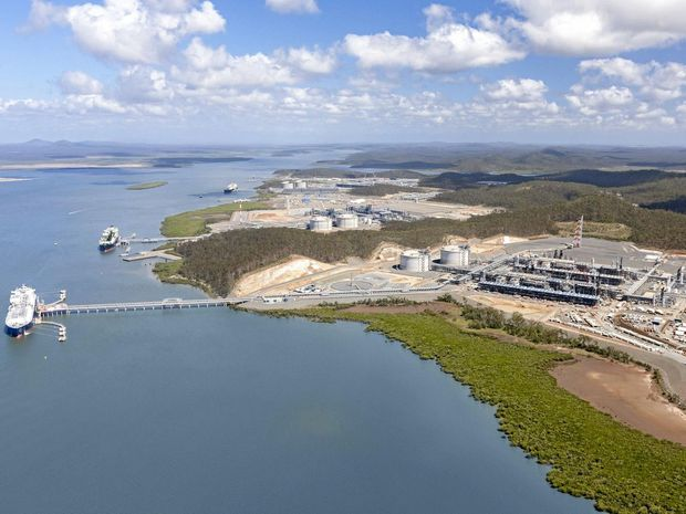 JOB DONE: An aerial view of the three LNG projects on Curtis Island all with ships at their jetties.
