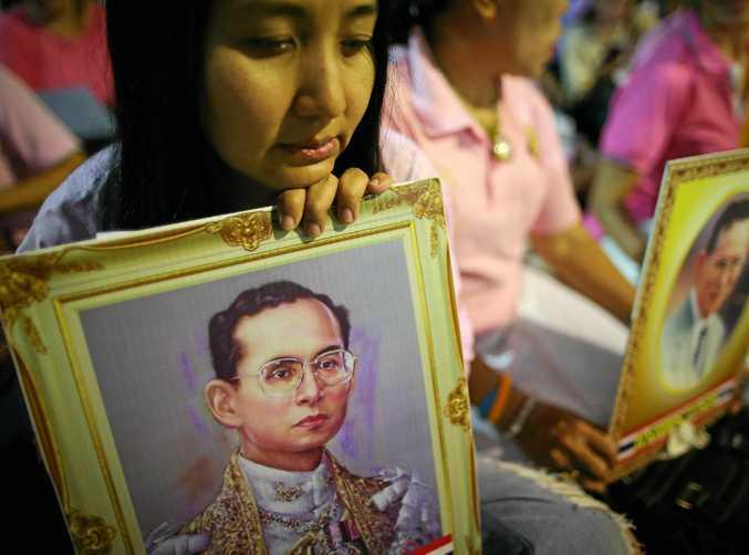 Thai well-wishers pray for a healthy recovery of King Bhumibol Adulyadej at the Siriraj Hospital in Bangkok.