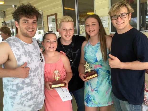 BACK IN WIDGEE: Brothers 3 (from left) Tayzin, Makiurm and Shardyn Fahey-Leigh at last year's Widgee Country Music Club's talent Quest with Natalya and Kiarnah of Sista Lee who won the Webb Brothers Perpetual Trophy. Brothers 3 will be back at Widgee for this year's talent quest.