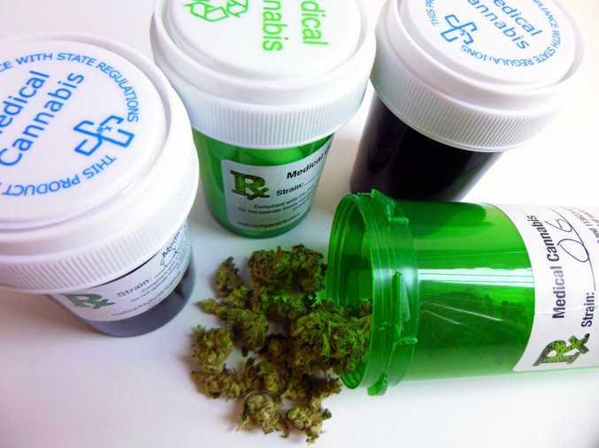 Close-up of four medical marijuana prescription containers.