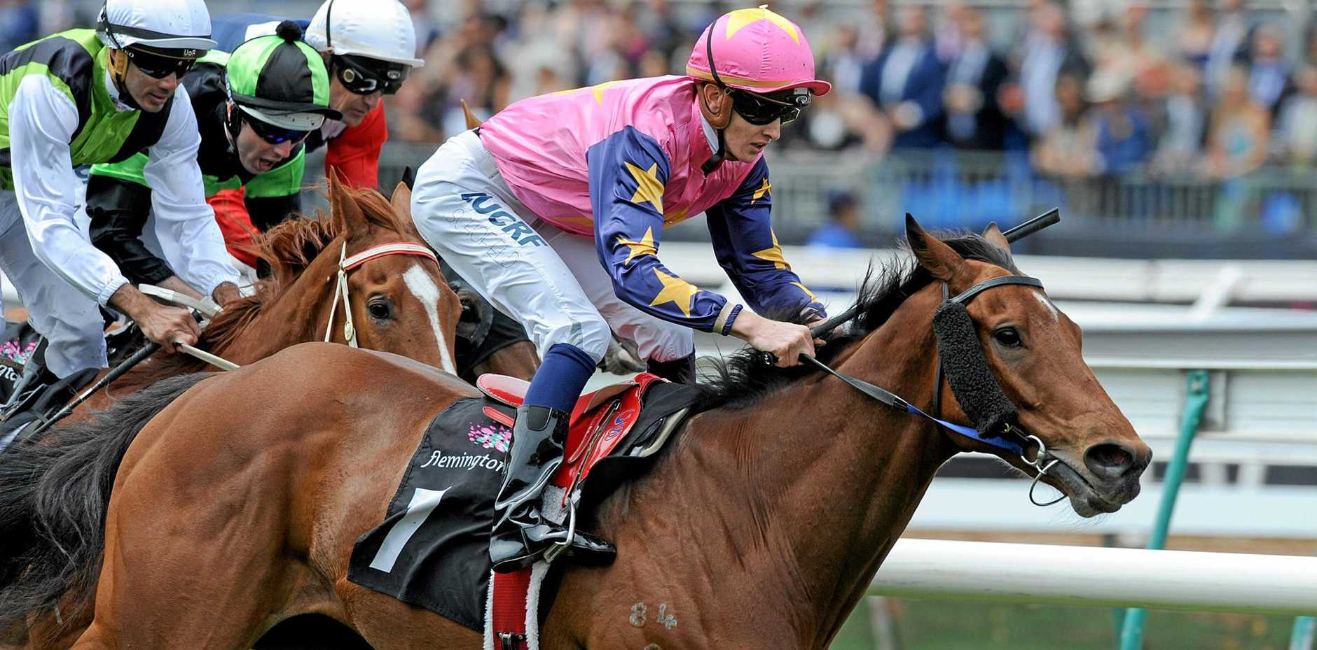 Jockey Chad Schofield rides De Little Engine to victory in the J.B. Cummings AM Tribute Plate on Melbourne Cup day last year.