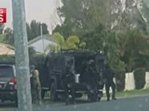 Siege called off after wanted man not found in house