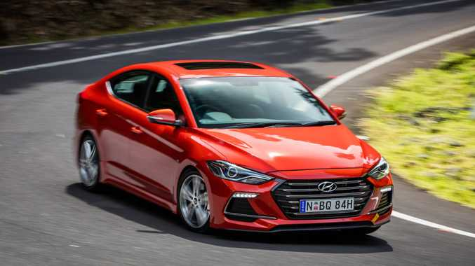 BACK ROAD HERO: Hyundai Elantra SR Turbo a stirring steer with a superb chassis and 150kW/265Nm turbo four-cylinder.