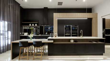 Will and Karlie's sleek black kitchen tied for first place.