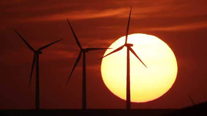 FILE - In this Aug. 23, 2013 file photo, wind turbines are silhouetted by the setting sun as they produce electricity . (AP Photo/Charlie Riedel, File)