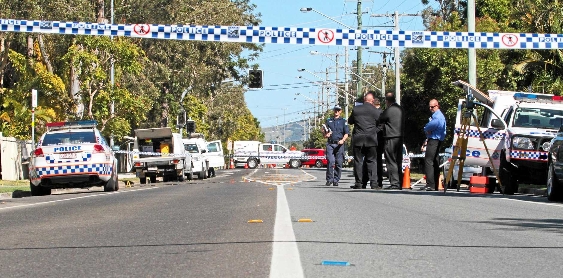Police on the scene of a double homicide and police shooting on Yandina Coolum Road, Coolum Beach.
