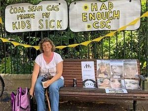 Tara woman protests about CSG sickness at Parliament
