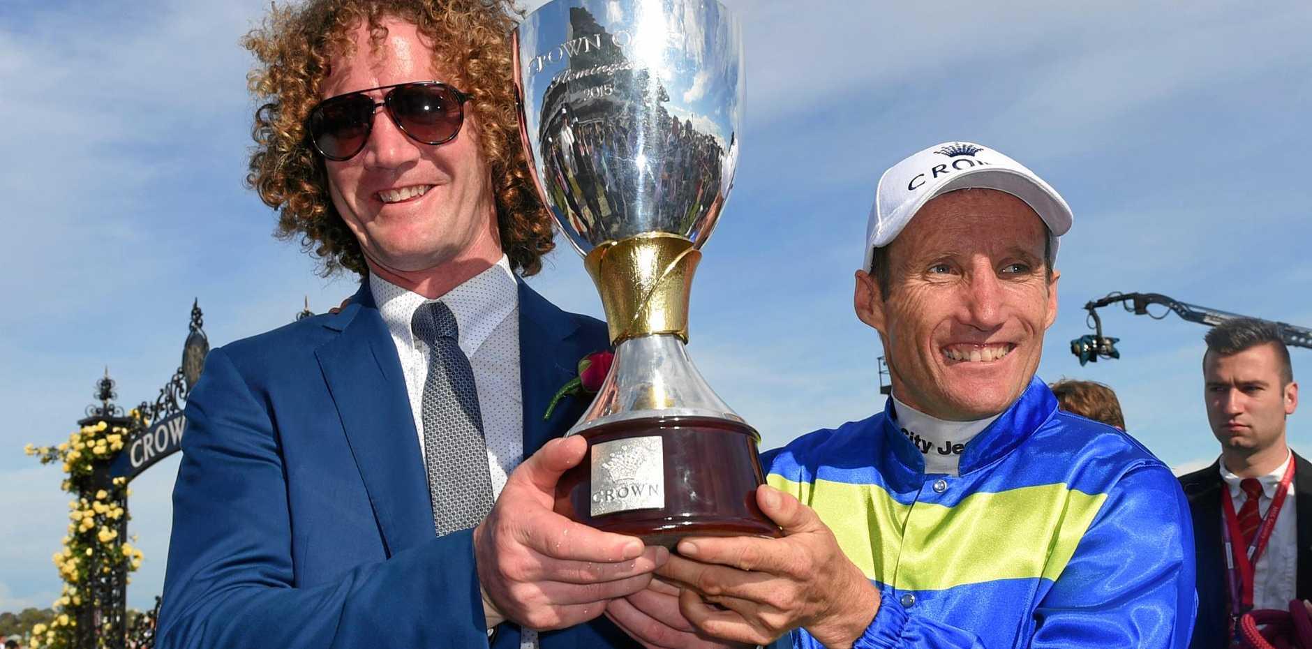 Trainer Ciaron Maher (left) and jockey Damien Oliver celebrate after Jameka won the Crown Oaks at Flemington Racecouse last November.