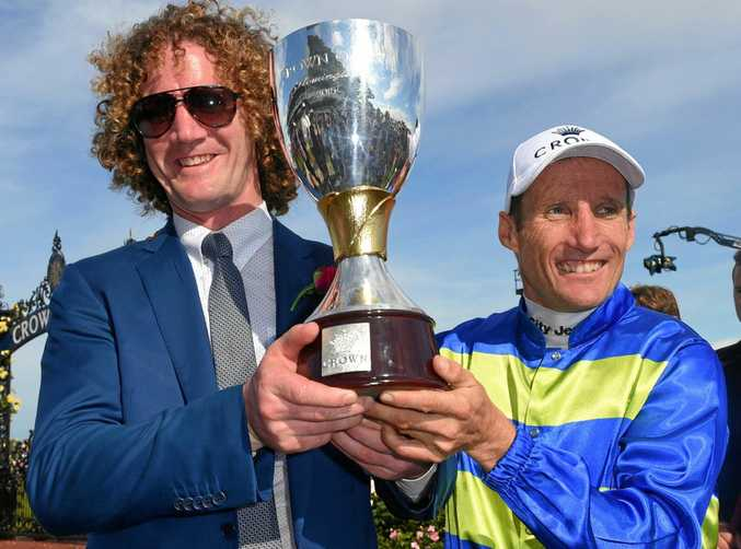 Trainer Ciaron Maher (left) and jockey Damien Oliver celebrate after Jameka won the Crown Oaks at Flemington Racecouse last November.