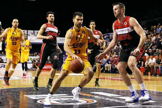 Kevin Lisch of the Sydney Kings drives to the basket during the round-two NBL match against the Illawarra Hawks.