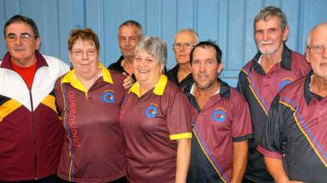 WHAT A GAME: Mike Battilana, Donna Abbott, Rhonda Payne, Robbie Richards, Peter Goodson and Allan Robins will represent Mackay in the Australian veterans championship at Sydneys Olympic Park next week, cheered on by supporters Kevin Abbott and Charlie Payne, at back.