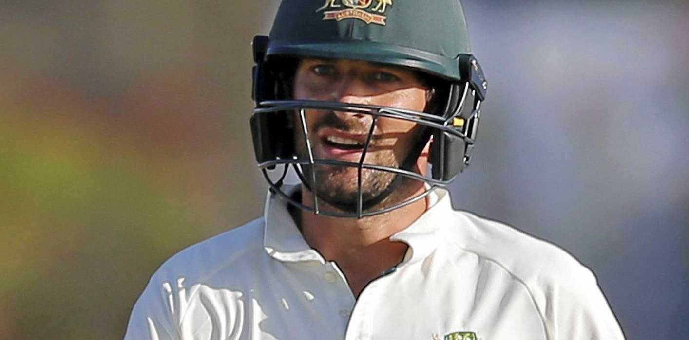 Australian batsman Joe Burns returns to the pavilion after being dismissed against Sri Lanka.