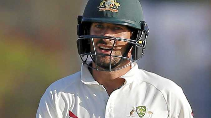 Australian batsman Joe Burns returns to the pavilion after being dismissed against Sri Lanka.