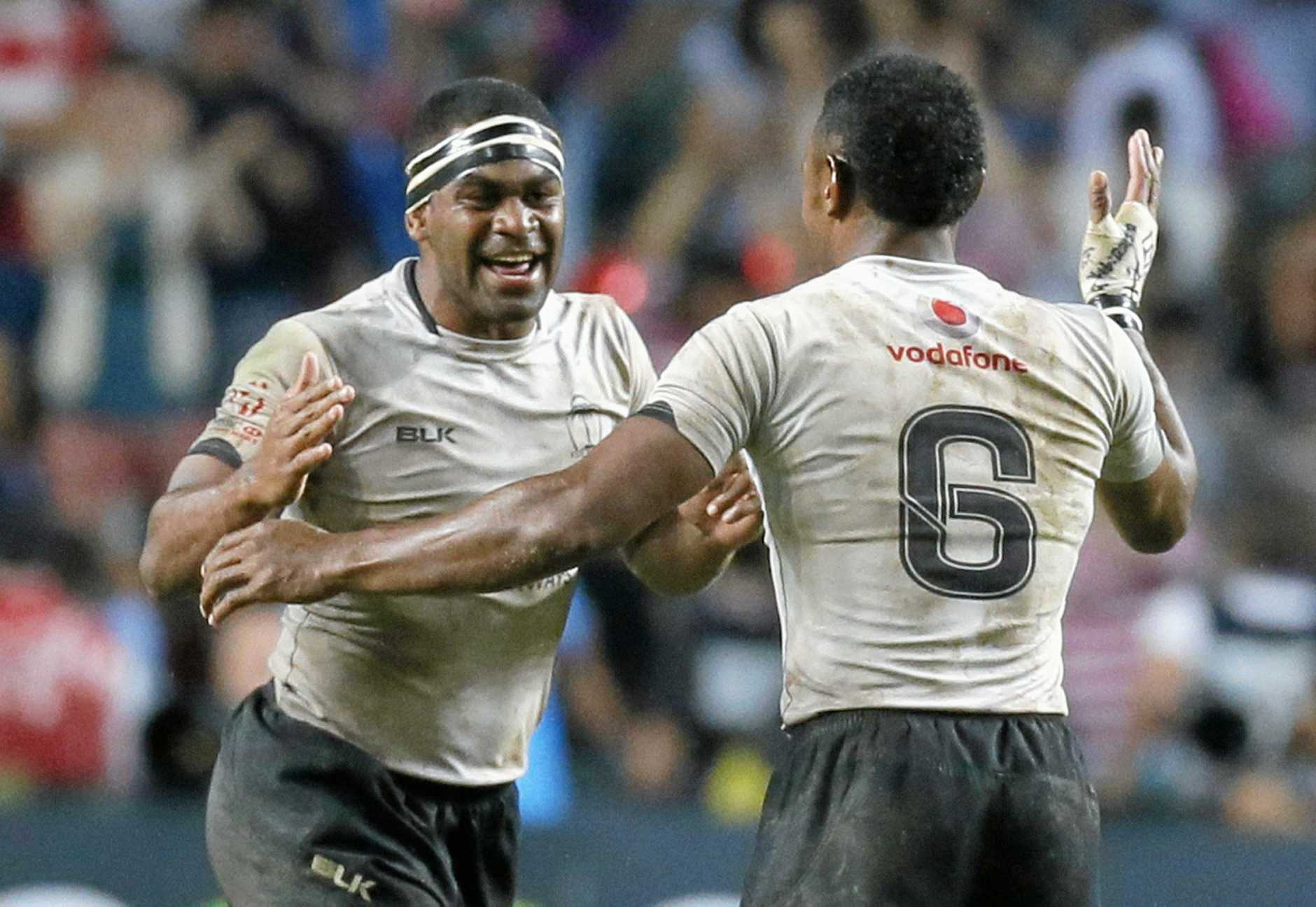 Fiji's Vatemo Ravouvou (left) and Amenoni Nasilasila celebrate after winning the final match of the Hong Kong Sevens rugby tournament in April.