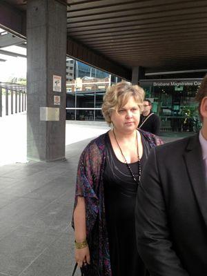 Judy Lorbek leaves Brisbane Magistrates Court.