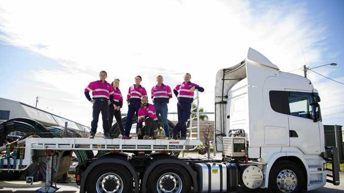 GOING PINK: Excavation Equipment staff (from left) David Drummond, Michelle Simons-Brown, Catherine Ardi, Padhraig Conway, Brad Dawson and Brian McBarron wear their pink work shirts to raise awareness of breast cancer in both men and women. INSET: Padhraig Conway drives a forklift at the company's work site in Toowoomba's industrial estate.