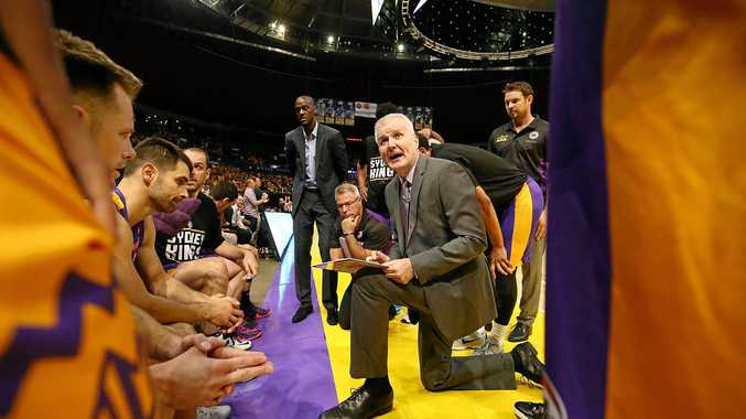 Sydney Kings coach Andrew Gaze talks to his players.