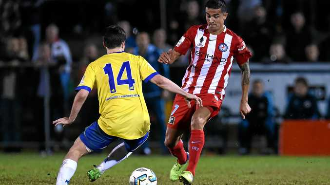 Tim Cahill of Melbourne City (right) competes for the ball with Jake McLean of the Brisbane Strikers during their round of 16 FFA Cup match at Perry Park in Brisbane in August.