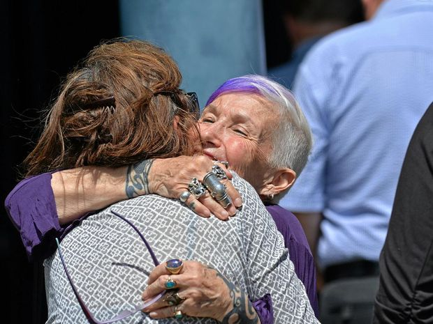 SUPPORT: Beth Dancing Free hugs a guest at her grandson Cheyne Turner-Goodman's farewell.