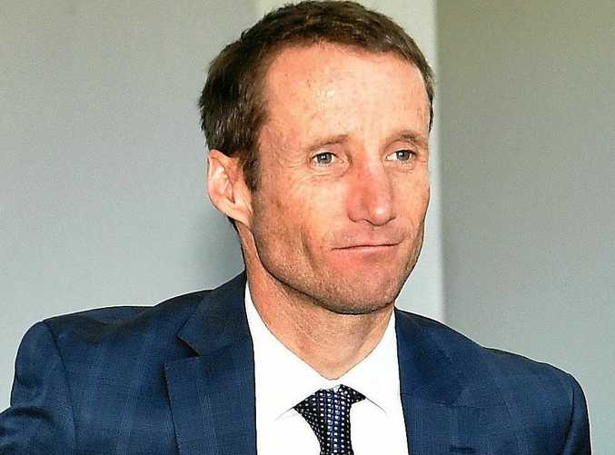 Jockey Damien Oliver leaves the appeal hearing in Melbourne.