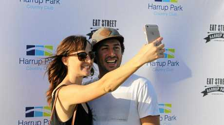 Leticia Mackenzie and Tristan Shalhoub snap a selfie as part of an Eat Street competition to win a $500 Porters voucher.