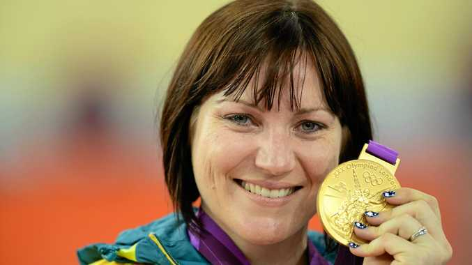 Australia's Anna Meares holds her gold medal after defeating great rival Victoria Pendleton in the women's sprint at the 2012 London Games.
