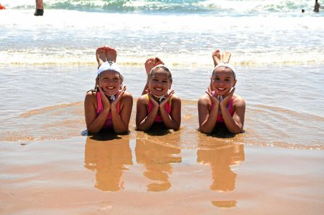 HAPPY NIPPERS: Summer, Mimi, and Indiana Woods enjoy the Surf Lifesaving program.