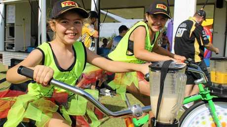 Sisters Ashley White and Emma White manning the ActiveBlendz blender bikes at Run for MI Life.