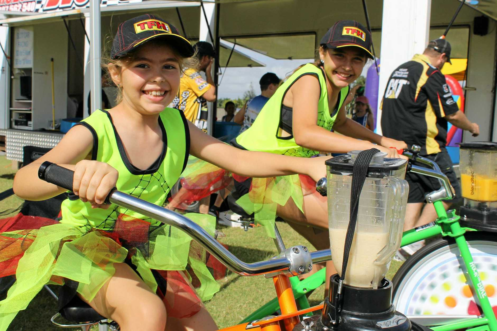 Sisters Ashley White and Emma White manning the ActiveBlendz blender bikes at Run for MI Life.