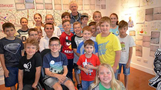 Terry Denton with young fans of Andy Griffiths' Treehouse series, which he illustrated.