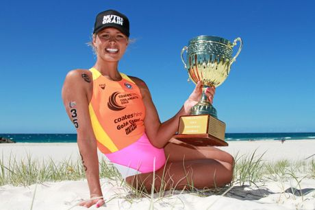 Courtney Hancock celebrates her second win in the gruelling Coolangatta Gold.