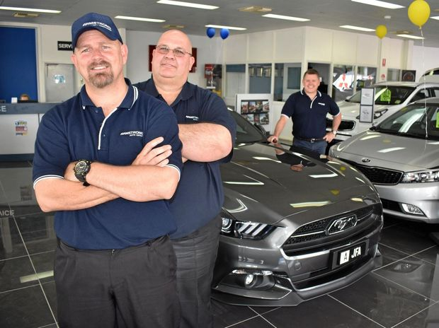 HAPPY BIRTHDAY: Armstrong Auto Group is celebrating one year in the Maranoa, much to the delight of Ivan Maunder, Ross Nicholas and owner John Armstrong.