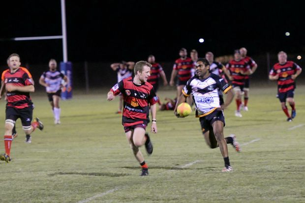 EARLY LEAD: Bundaberg Turtles fullback Willie Nagas tries to get past a Bundaberg West Barbarians defender in their Spring Cup clash on Friday night.