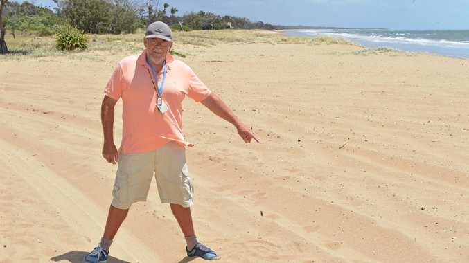 EROSION: Moore Park resident Rick Glass stands on high dunes four-wheel drives have denuded while behind him is the area drivers don't go covered in vegetation. He says something needs to be done to stop four-wheel drivers driving high on the dunes.