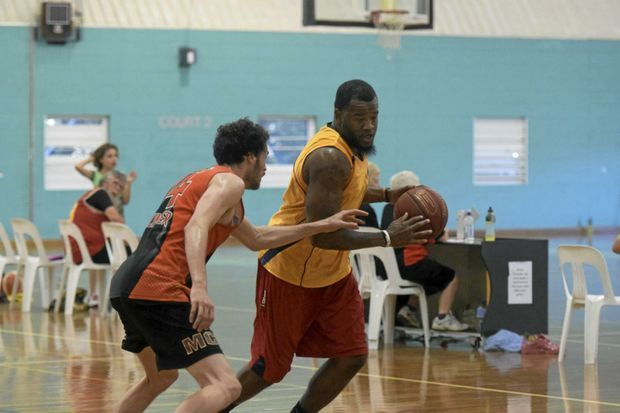 Downtown Funky Stuff centre Will Shankland pushes his way around a Bellingen Braves defender to score a lay-up in the Jacaranda Carnival A-grade final at the Grafton Indoor Sports Centre.