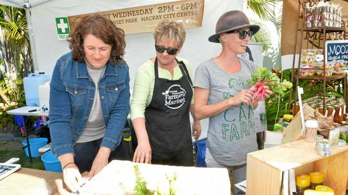 Wendy King, Rosmarie Fornaro-Widmer and Tegan McBride at the Greater Whitsunday Farmers' Markets on Wood St.