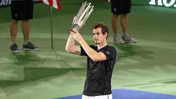 Andy Murray holds up his the Shanghai Masters trophy after defeating Roberto Bautista Agut of Spain.