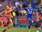 Brisbane Roar's Brett Holman takes a shot at goal against the Newcastle Jets.