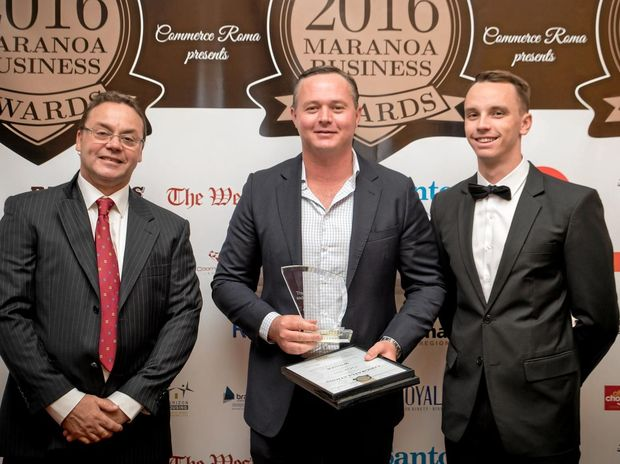 WINNERS: Ezyquip Hire's Mark McKenzie accepts the Trades, Professions and Services Award from TAFE South-West's Don Shaw and Commerce Roma vice-president Brodie Albeck.