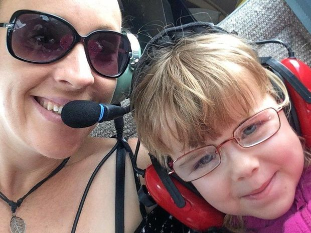 TAKING FLIGHT: Jess and her daughter Breeanna Selmes on one of the Angel Flight planes.