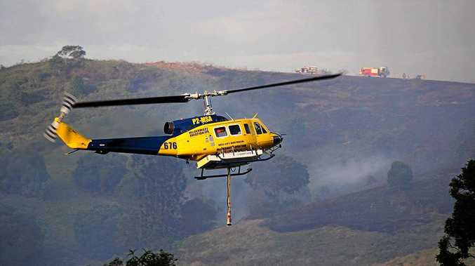 HEAVY RESPONSE: One of the three helicopters used by fire teams at Carters Ridge near Kilkivan on Sunday.
