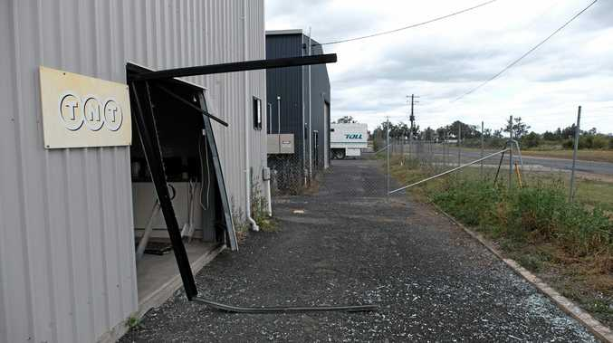 The damage at the Followmont Transport shed after a group of people allegedly stole a van and drove through the business' glass sliding door and fence.