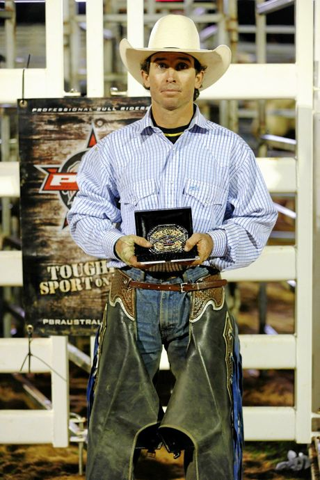 AT LAST: Jason Mara with his new buckle and cash prize after claiming the Toowoomba PBR on Saturday.
