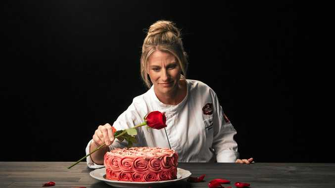 BAKE IT: Michel's Patisserie chef Bev Ward with one of their stunning rosette cakes to celebrate Cake Week on the Great Australian Bake Off.