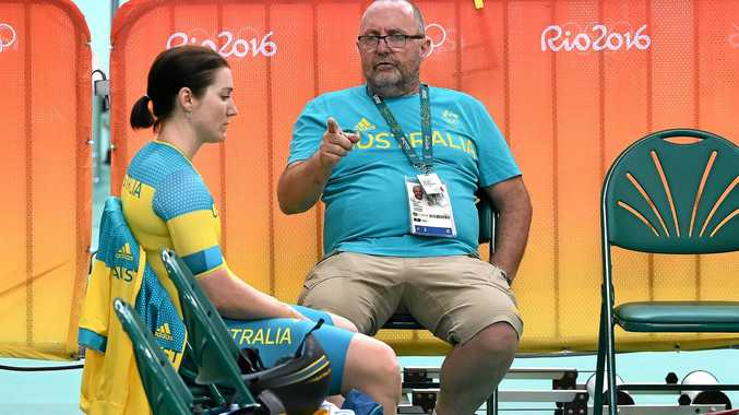 Australian coach Gary West talks with Anna Meares during a training session at the Rio Olympic Games velodrome.