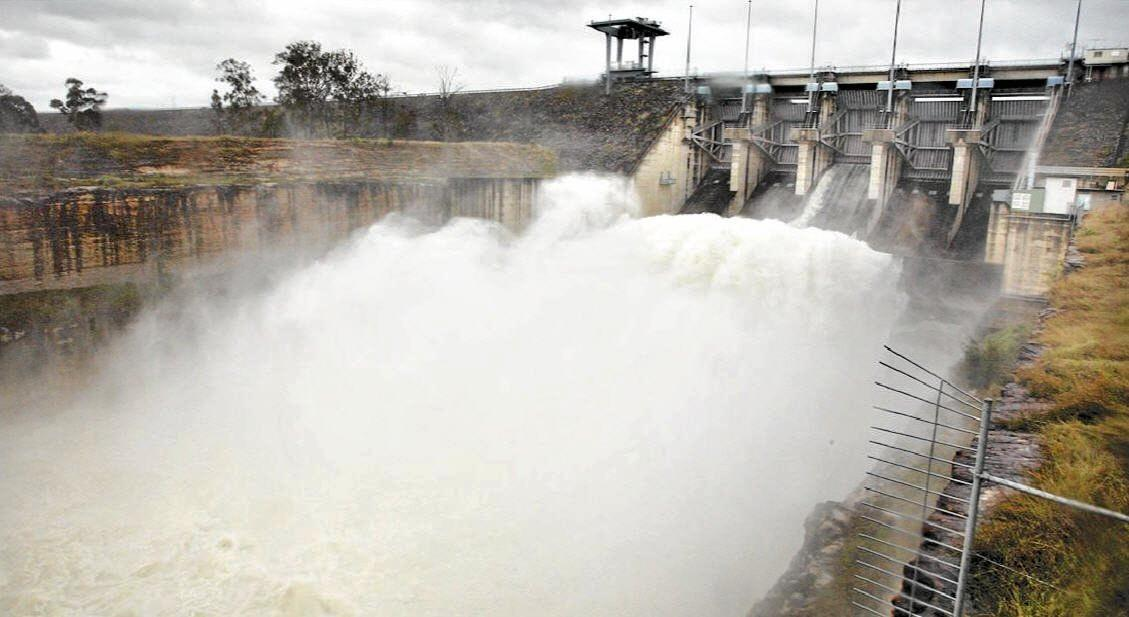 Water flows over the spillway at the Wivenhoe Dam.