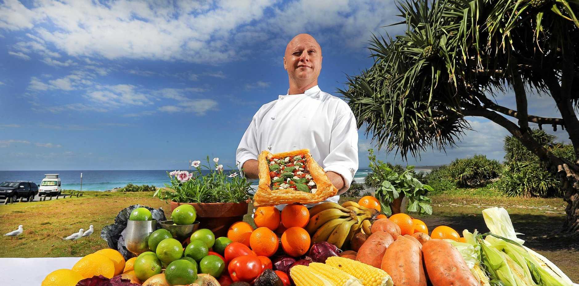 YUM YUM Black Oak chef Doron Daws prepares for the Tweed Foodie Fest on Saturday. PHOTO: Scott Powick