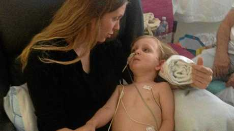 Eli Giles, 2, pictured with his mum Brittany at the Lady Cilento Children's Hospital after waking up from sedation.
